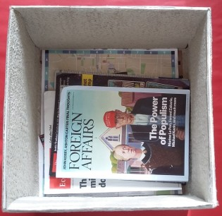 Cardboard boxes or baskets can hold the magazines you are currently reading.